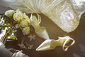 Wedding shoes with bouquet of  roses  on chair - PhotoDune Item for Sale