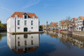Cityscape of Delft with historic houses and army museum, the Netherlands - PhotoDune Item for Sale