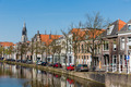 Cityscape of Delft with canal and historic houses, the Netherlands - PhotoDune Item for Sale