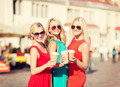 women with takeaway coffee cups in the city - PhotoDune Item for Sale