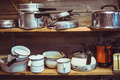shelves cluttered with pots and pans - PhotoDune Item for Sale