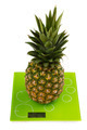 Pineapple on square kitchen scales - PhotoDune Item for Sale