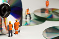 Miniature people in action with CDs - PhotoDune Item for Sale