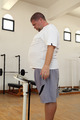man with overweight on scales in gym - PhotoDune Item for Sale
