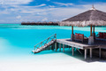 Over water jetty with steps into tropical lagoon - PhotoDune Item for Sale