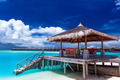 Boat jetty with steps on a tropical island of Maldives - PhotoDune Item for Sale