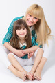 Mother and daughter with long hair with bangs hugging and smiling - PhotoDune Item for Sale