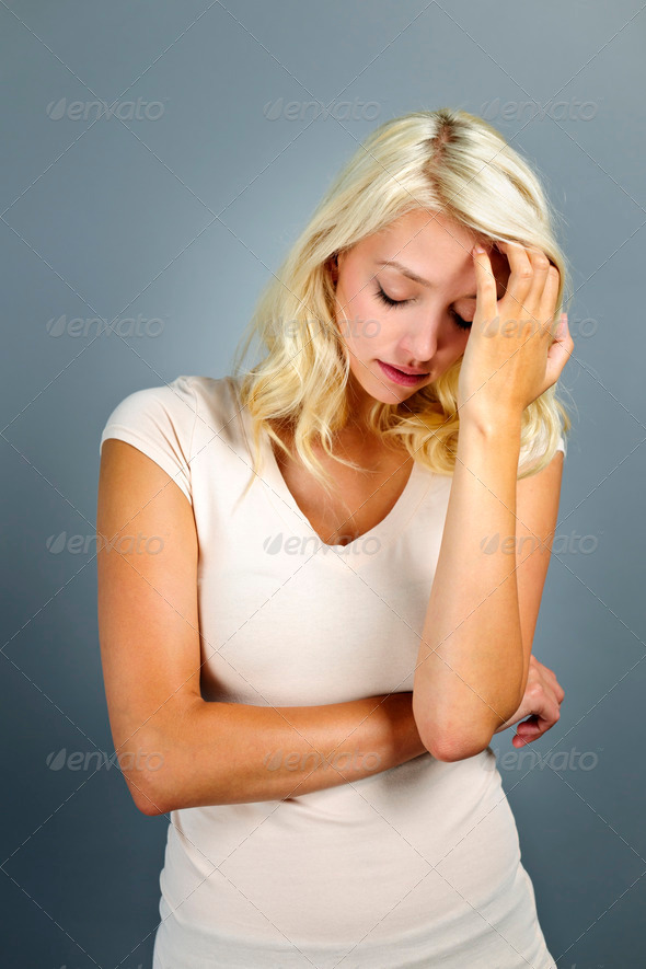 Stressed young woman - Stock Photo - Images
