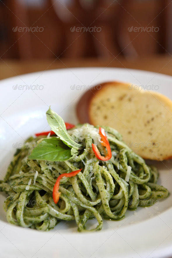 spaghetti with pesto sauce on wood background - Stock Photo - Images