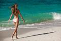 Bronze Tan Woman Sunbathing At Tropical Beach - PhotoDune Item for Sale