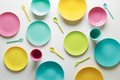 Colorful plastic dishes on white background - PhotoDune Item for Sale