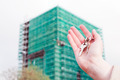 A real estate agent holding keys to a new apartment in her hands. - PhotoDune Item for Sale