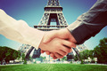 Business in Paris, France. Handshake on Eiffel Tower background - PhotoDune Item for Sale