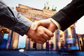 Business in Berlin. Handshake on Brandenburg Gate background. - PhotoDune Item for Sale
