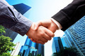 Business handshake, skyscrapers background. Deal, success, cooperation - PhotoDune Item for Sale