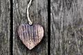 A wooden vintage heart on grunge wood planks. Symbol of love, - PhotoDune Item for Sale