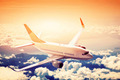 Airplane in flight. A big passenger or cargo aircraft, airline above clouds. - PhotoDune Item for Sale