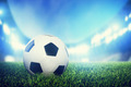 Football, soccer match. A leather ball on grass on the stadium - PhotoDune Item for Sale