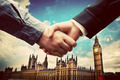 Business in London. Handshake on Big Ben, Westminster background - PhotoDune Item for Sale