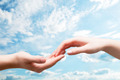 Man and woman hands touch in gentle, soft way on blue sunny sky - PhotoDune Item for Sale