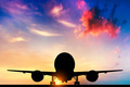 Airplane ready to take off. Silhouette of a big passenger or cargo aircraft, airline at sunset - PhotoDune Item for Sale