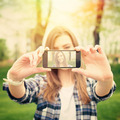 Beautiful young woman taking a selfie photo with phone - PhotoDune Item for Sale