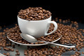 Cup and saucer full of coffee beans with a spoon - PhotoDune Item for Sale