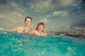 Child and mother in swimming pool - PhotoDune Item for Sale