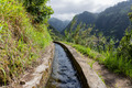 Levada, irrigation canal with hiking path at Madeira Island, Portugal - PhotoDune Item for Sale