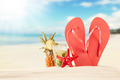Summer beach with red sandals and shells - PhotoDune Item for Sale
