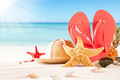 Summer beach with straw hat, seashells and sandals - PhotoDune Item for Sale