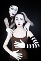 mime man tempts woman on a black background - PhotoDune Item for Sale