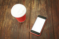 Smart phone and takeaway coffee cup on wooden table - PhotoDune Item for Sale