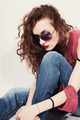 portrait of a sad young woman wearing sunglasses - PhotoDune Item for Sale