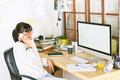 Young entrepreneur woman using cellphone on home office. - PhotoDune Item for Sale