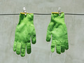 Green gloves hanging on a wire in the sunlight - PhotoDune Item for Sale