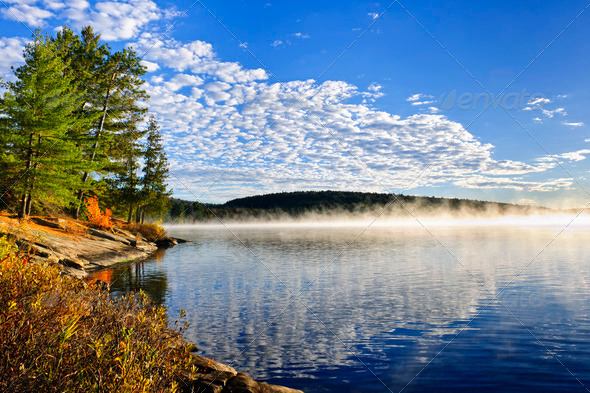 Autumn lake shore with fog - Stock Photo - Images
