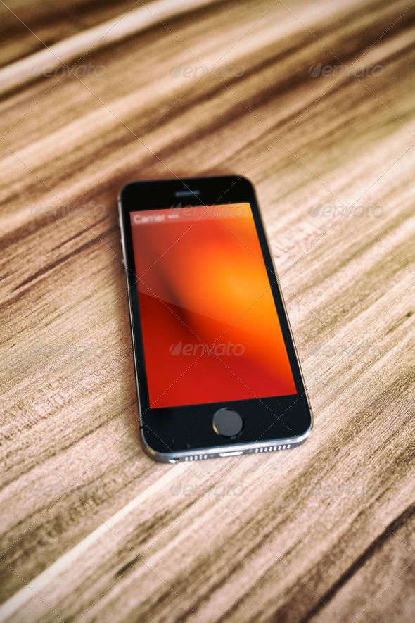 GraphicRiver Natural Smartphone on Elegant Wood Table Mock Up 7841877
