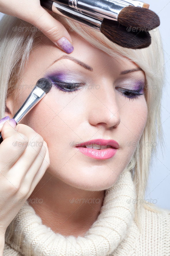 Makeup artist applying eyeshadow - Stock Photo - Images