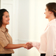 Two professional females giving hands greeting - PhotoDune Item for Sale