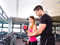 Gym personal trainer man with dumbbell woman - PhotoDune Item for Sale