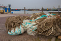 Pile of Fishing Nets on the Quay of a Fishing Harbor - PhotoDune Item for Sale
