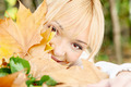 young blonde behind the leaves - PhotoDune Item for Sale