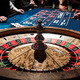 Wooden Shiny Roulette Details in a Casino and People - PhotoDune Item for Sale