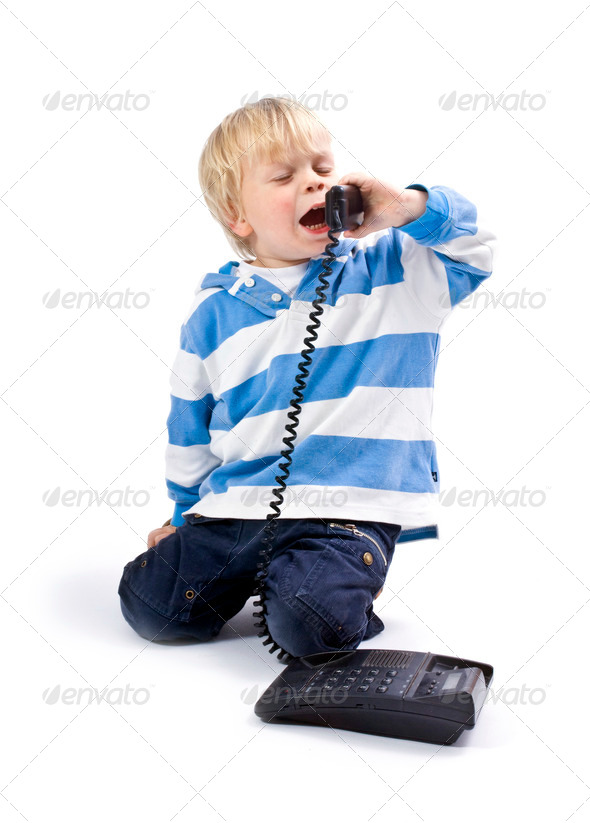 Small boy on the phone - Stock Photo - Images