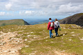 Two hikers walking on Snowdonia, Wales, UK - PhotoDune Item for Sale