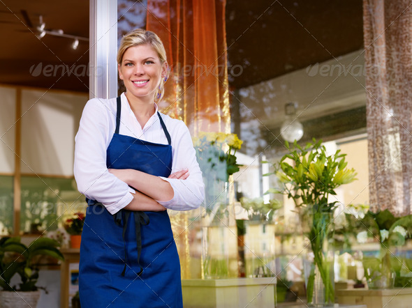 PhotoDune Young pretty woman working as florist in shop and smiling 848062