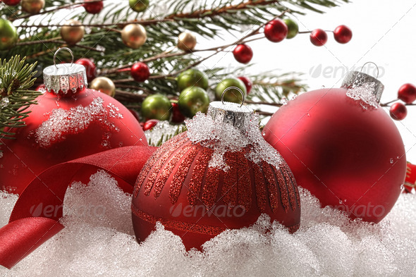 Red christmas balls in the snow - Stock Photo - Images