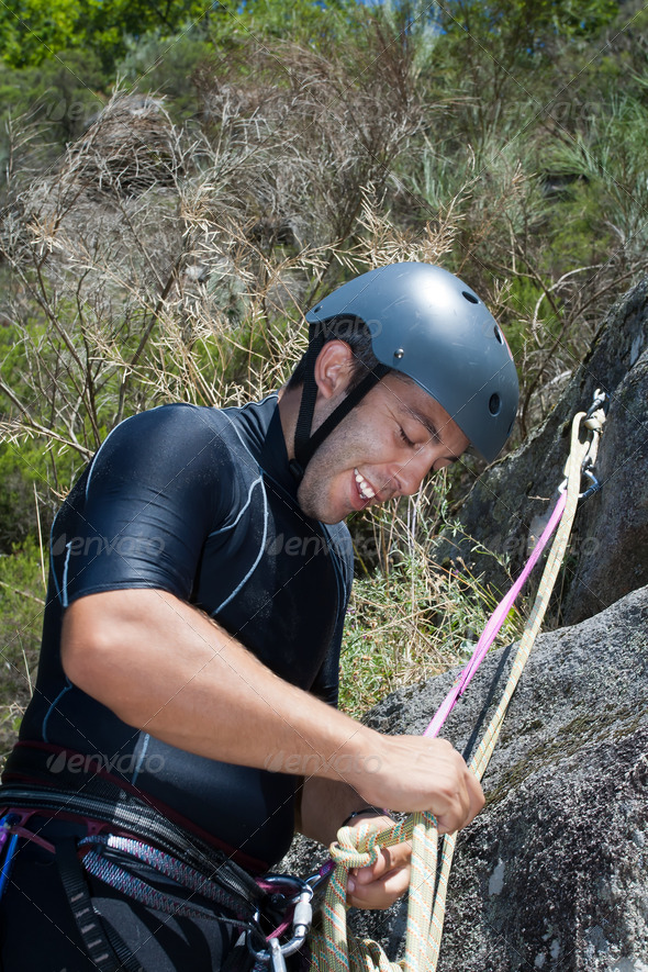 Men with rope for rappelling - Stock Photo - Images
