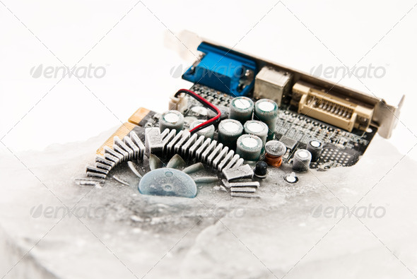 frozen computer part in ice cube on winter time - Stock Photo - Images